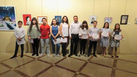 Juan López de Pablo junto a los ganadores del certamen