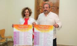 Labián y Ramírez con los carteles del ciclo de conciertos de la Diputación
